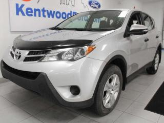 Used 2013 Toyota RAV4 LE AWD with a cream and black interior in satisfying silver for sale in Edmonton, AB