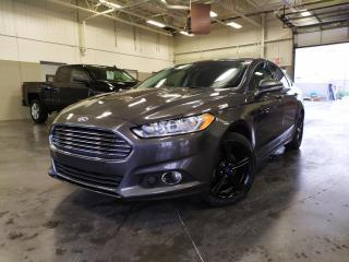 Used 2016 Ford Fusion SE/2.0L/BLUETOOTH/SIEGE CHAUFFANT/CAMERA DE RECUL for sale in Blainville, QC