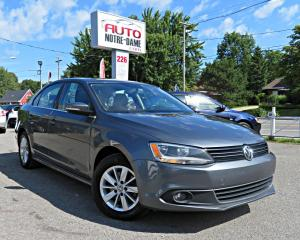 Used 2014 Volkswagen Jetta TSI HIGHLINE TOIT OUVRANT A/C CAMERA REC for sale in Repentigny, QC