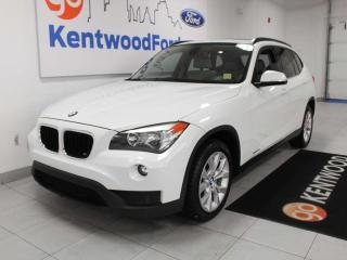 Used 2014 BMW X1 xDrive28i AWD with sunroof, power heated leather seats, and auto start/stop for sale in Edmonton, AB