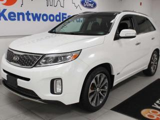 Used 2014 Kia Sorento SX AWD with power heated leather seats, sunroof, power liftgate, auto start/stop, back up cam, and NAV for sale in Edmonton, AB