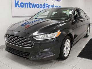 Used 2014 Ford Fusion SE FWD with keyless entry and power seats for sale in Edmonton, AB
