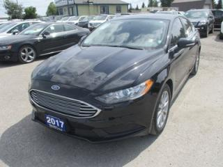 Used 2017 Ford Fusion GAS SAVING SE MODEL 5 PASSENGER 2.5L - DOHC.. HEATED SEATS.. TOUCH SCREEN.. BACK-UP CAMERA.. BLUETOOTH SYSTEM.. CD/USB INPUT.. for sale in Bradford, ON