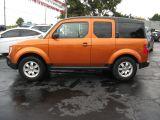 Photo of Orange 2006 Honda Element