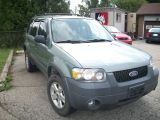 Photo of Green 2006 Ford Escape