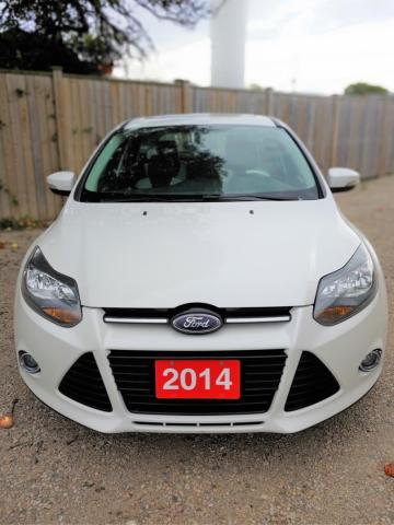 2014 Ford Focus Titanium Hatch heated leather seats,navigation,low mileage,Financing for all credit situations.