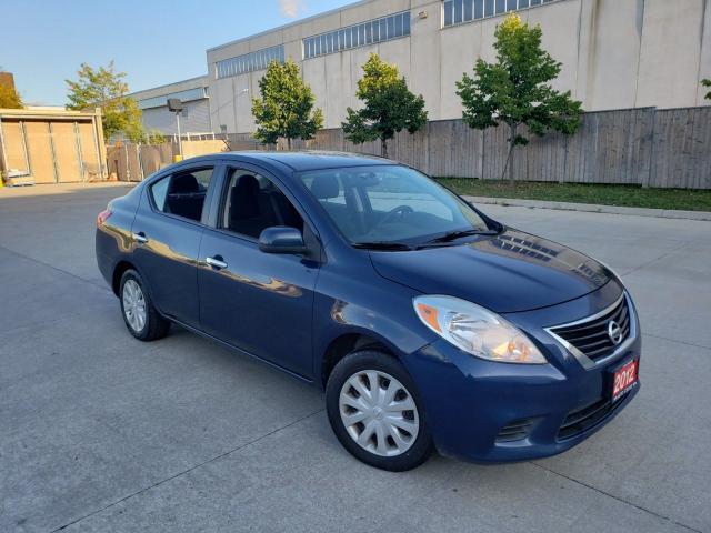 2012 Nissan Versa SV, Auto, 4 door, 3/Y warranty available.