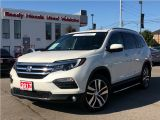 Photo of White 2017 Honda Pilot