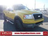 Photo of Yellow 2004 Ford F-150