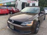 Photo of Brown 2014 Volkswagen Jetta