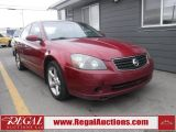 Photo of Red 2005 Nissan Altima