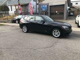 Photo of Black 2013 BMW X1