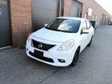 Photo of White 2012 Nissan Versa