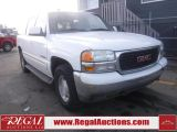 Photo of White 2004 GMC Yukon XL