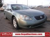 Photo of Green 2002 Nissan Altima