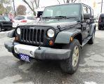 Photo of Green 2012 Jeep Wrangler