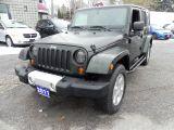 Photo of Green 2011 Jeep Wrangler