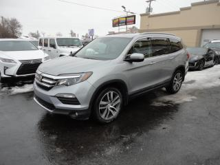 Used 2017 Honda Pilot Touring AWD Cuir DVD Toit Pano Nav for sale in Laval, QC