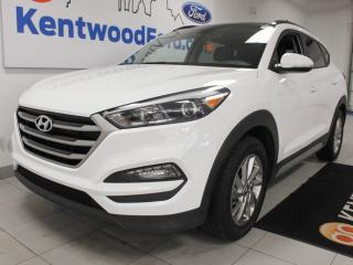 Used 2018 Hyundai Tucson SE 2.0L AWD with a sunroof, heated power leather seats, heated steering wheel, heated rear seats and a back up cam for sale in Edmonton, AB