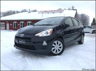 Used 2014 Toyota Prius C hybrid synergy drive for sale in Richmond, QC
