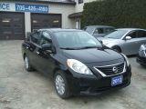 Photo of Black 2012 Nissan Versa