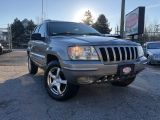 Photo of PLATINUM 2002 Jeep Grand Cherokee