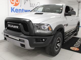 Used 2016 RAM 1500 5.7L Hemi Rebel with a sunroof, heated power leather seats, heated steering wheel and red interior for sale in Edmonton, AB