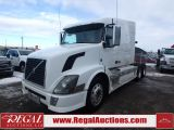 Photo of White 2010 Volvo VNL SLEEPER T/A HIGHWAY TRACTOR