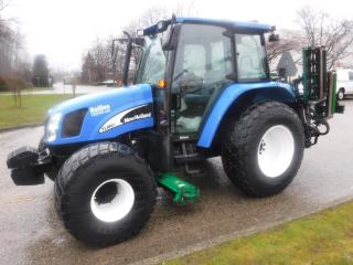 Used 2007 NEW HOLLAND TC100 Tractor 4 wheel Drive Grass Cutter Diesel for sale in Burnaby, BC