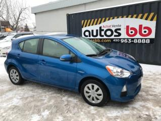 Used 2014 Toyota Prius c Hybride for sale in Laval, QC