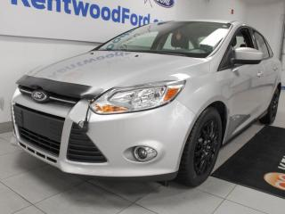 Used 2012 Ford Focus SE 5-SPD manual in satisfying silver for sale in Edmonton, AB