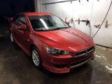 Photo of Red 2013 Mitsubishi Lancer