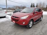 Photo of Red 2011 Hyundai Tucson