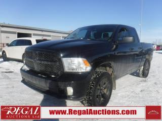 Used 2014 RAM 1500 4D Quad CAB 4WD for sale in Calgary, AB