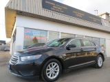 Photo of Black 2014 Ford Taurus