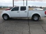 Photo of White 2013 Nissan Frontier