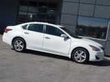 Photo of Pearl White 2014 Nissan Altima