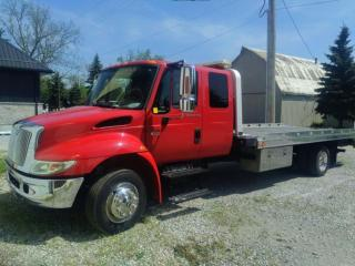Used 2007 International 4300 DT466 DIESEL FLATBED TOW TRUCK for sale in Jarvis, ON