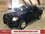Photo of Blue 2006 Nissan Frontier