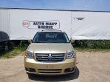 Photo of Gold 2010 Dodge Grand Caravan