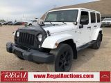 Photo of White 2014 Jeep Wrangler