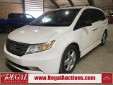Photo of White 2011 Honda Odyssey