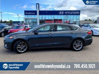 Used 2020 Ford Fusion Hybrid TITANIUM/HYBRID/LEATHER/ROOF/NAVI for sale in Edmonton, AB