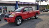 Photo of Red 2012 Nissan Titan
