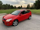 Photo of Red 2009 Hyundai Elantra Touring