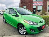 Photo of Green 2011 Mazda MAZDA2