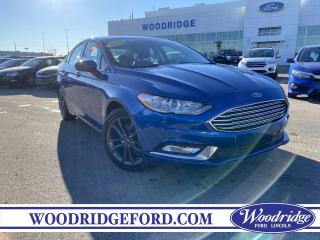 Used 2018 Ford Fusion ***PRICE DROP*** 2.0L, AWD, CLOTH SEATS. for sale in Calgary, AB