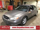 Photo of Gold 2002 Ford Taurus