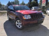 Photo of Red 2009 Jeep Grand Cherokee