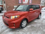 Photo of Orange 2012 Scion xB